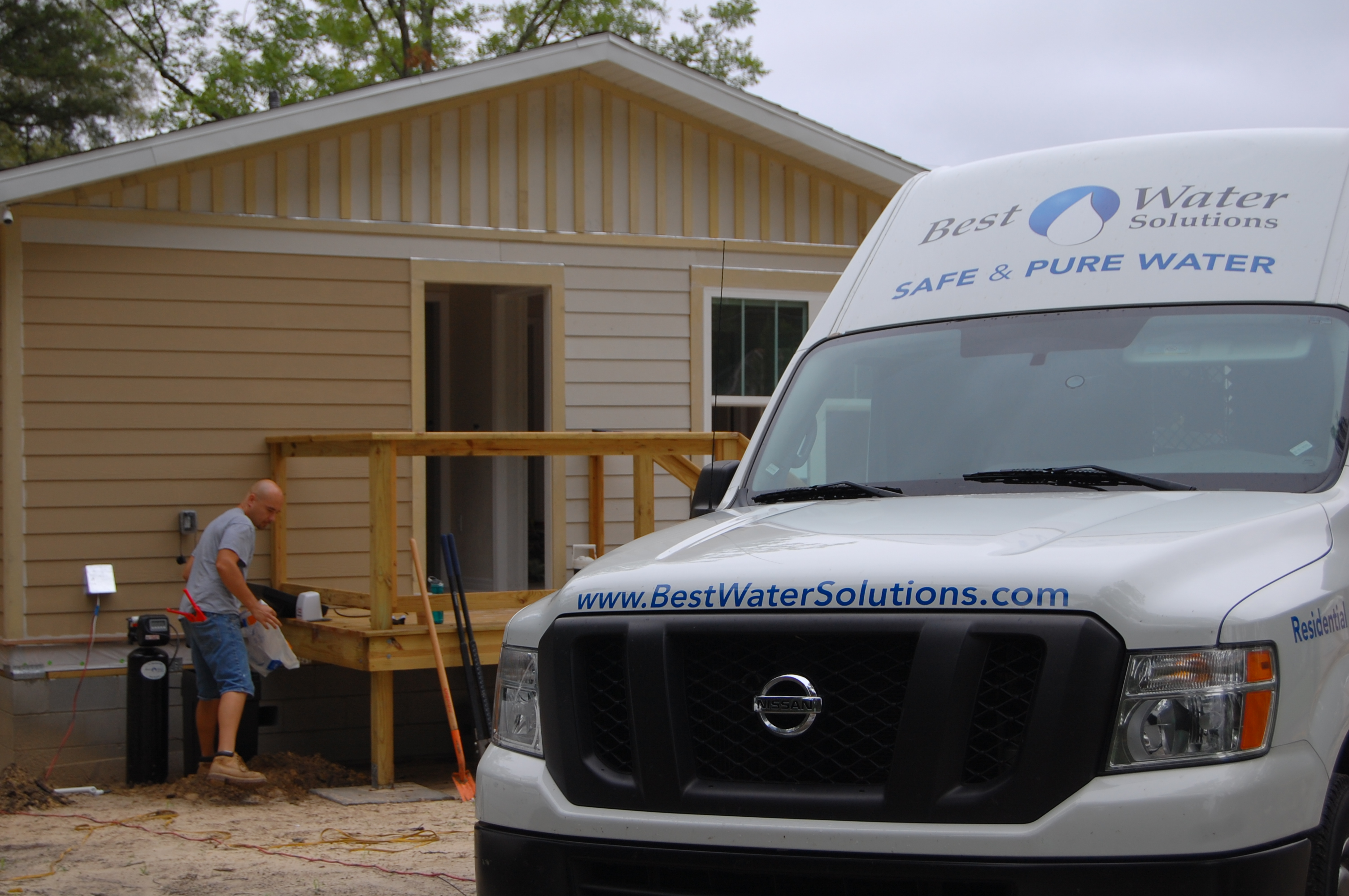 Image of Roy and our truck at the Habitat for Humanity installation project.