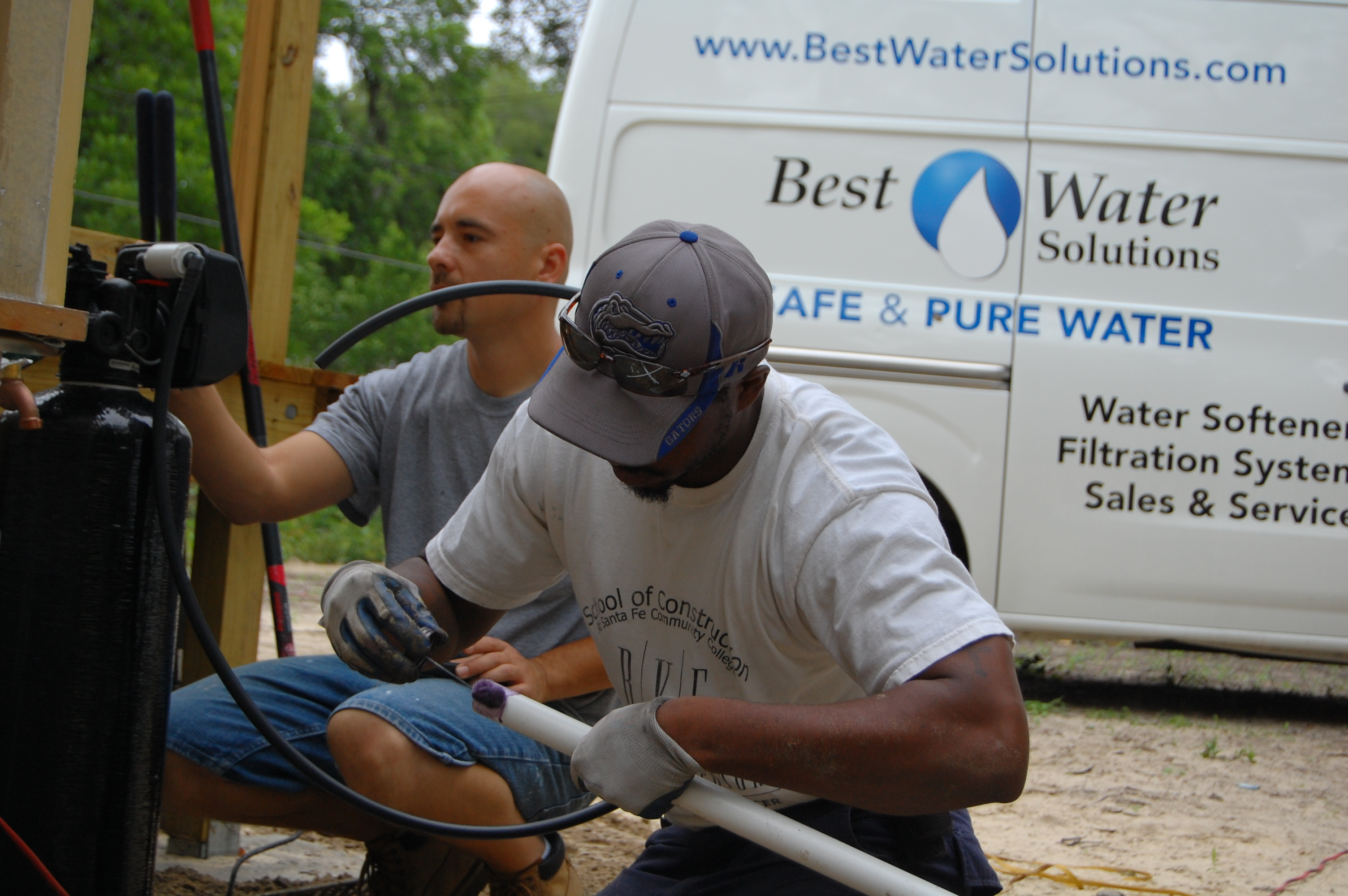 Image of Roy and a Perry Center Apprentice at work during the installation for Habitat for Humanity.