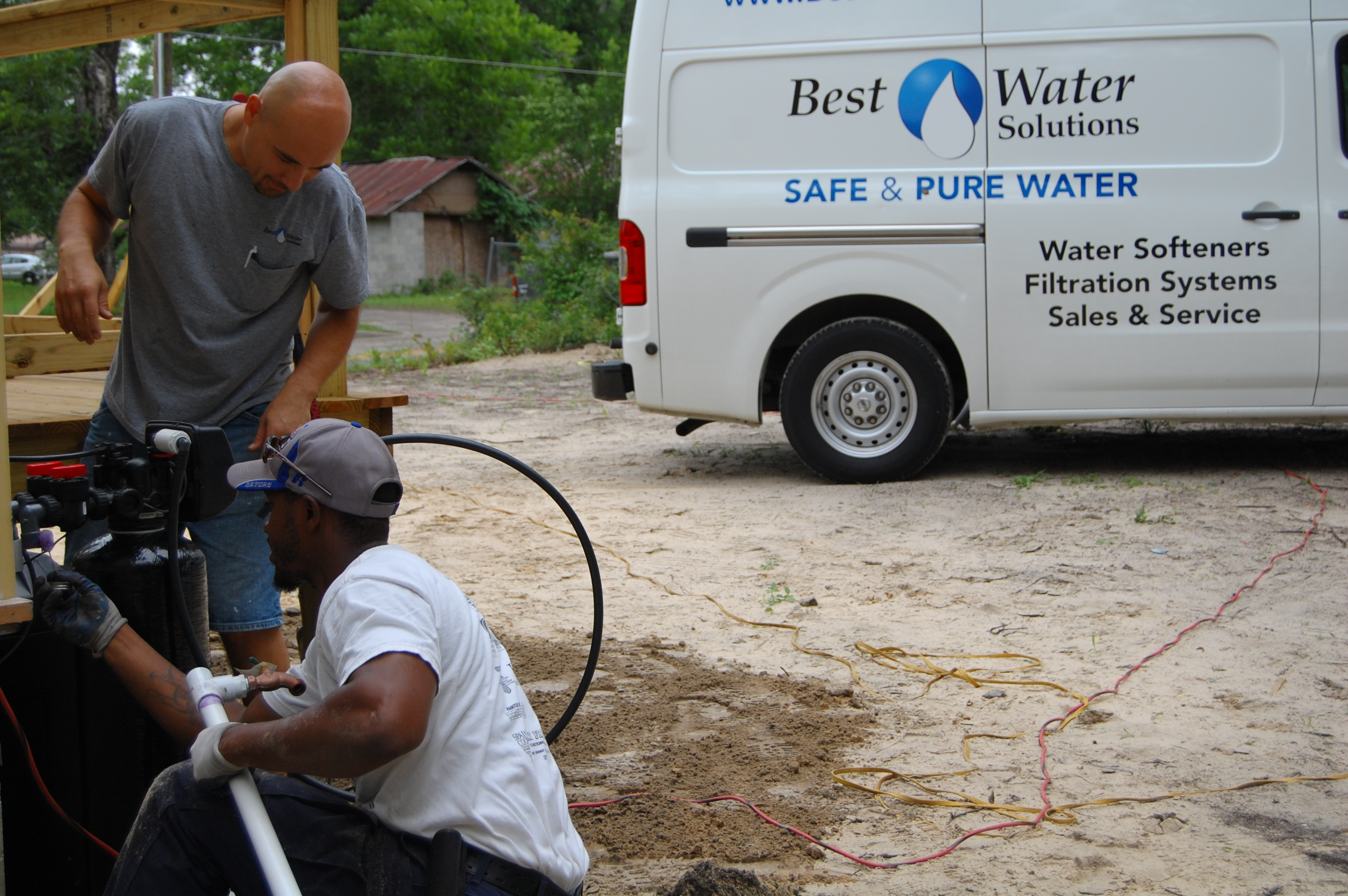 Image of Roy and a Perry Center Apprentice working to install our equipment for Habitat for Humanity.